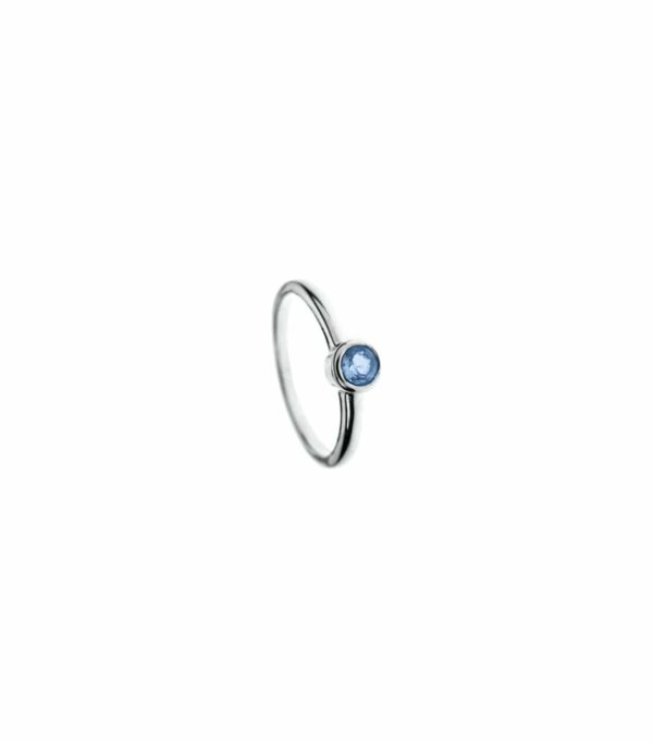 Silver Solitaire Topaz Ring